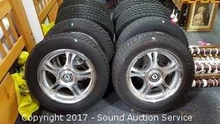 """4 American Racing Uni Lug 16"""" Rims w/Studded Tires"""